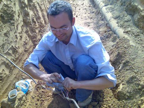 me fixing the telephone cables in Abuja